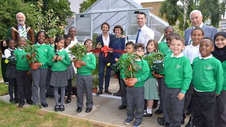 Pupils from Year 2 with, from left, Paul Rochford, Master of the Worshipful Company of Gardeners, Cl