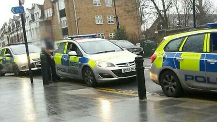 Police on the scene in Dunsmure Road, Stamford Hill. Credit: @Shomrim