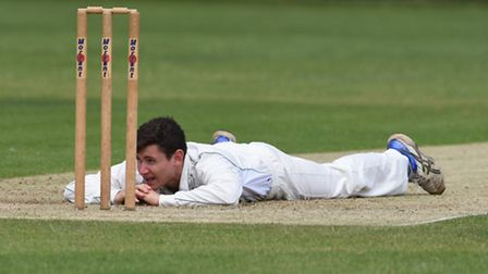 Shepherd's Bush bowler Tom Felton ponders a dropped caught and bowled chance. Pic: Paolo Minoli