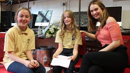 Charlotte Shaw, left, and Ivy Nicholls, centre, interview Lily James at Brecknock Primary School. Pi