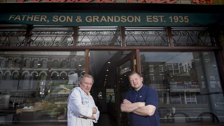 Arthur stands outside his cafe with his grandson (Pictures: John Macdonald-Fulton)