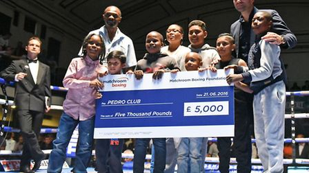 James Cook (second left) of Pedro ABC receives a cheque from the Matchroom Foundation Charity at Yor