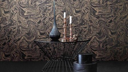 Marbled charcoal and rose gold wallpaper, £20 per roll, available from Graham and Brown. PA Photo/Ha