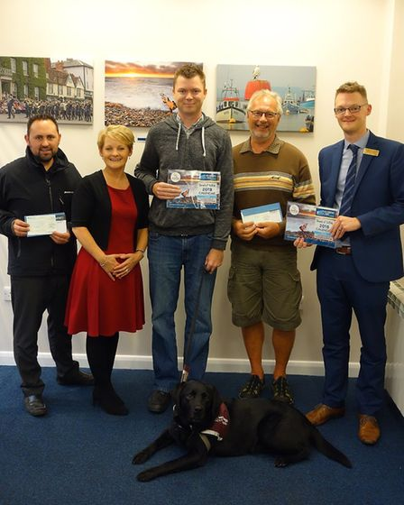 Winners of the Sounds of Suffolk photography competition with representatives from the Hearing Care