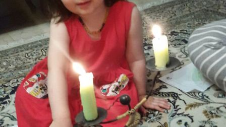 Gabriella Ratcliffe helped light a candle for her mother