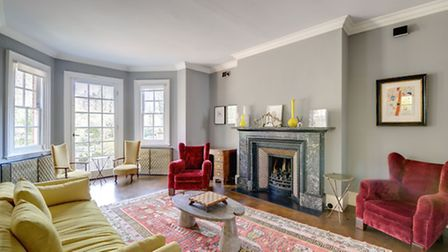 Features like this fireplace and floor-to-ceiling windows give the house an edge on the competition