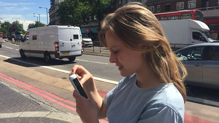 Prudence Ivey catching Pokemon on Finchley Road