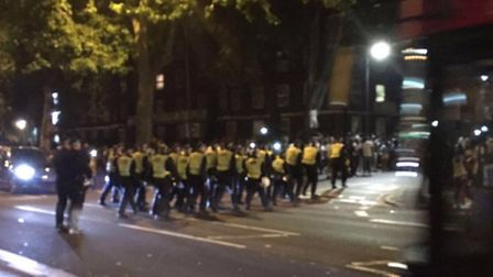 Police march on the Stamford Hill block party. (Picture: @999London)