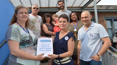 Petition of support for Abacus Belsize Primary School. Headteacher Vicki Briody (front left) and par