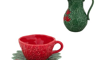 The Bordallo Pinheiro Strawberry Coffee Cup and Saucer, 22.30, and matching Pitcher, 47.50, availabl