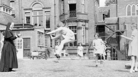 Skipping with a sister in the garden