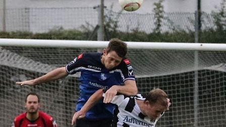 Sean Cronin leaps to win a header during Monday's victory over Maidenhead. Pic: Martin Addison