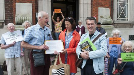 Activists Dr Wolfgang Kieran and Chris Roche hand petition to Catherine West MP, who supports their