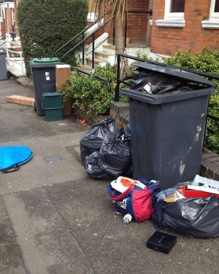 Overflowing bins in Milton Avenue - on the Haringey side of Highgate - where household waste is only