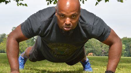 Row: Dominic Benjamin works out in Clissold Park (Picture: Polly Hancock)
