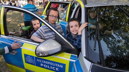 Youngsters in a police car at the Shomrim Open Day