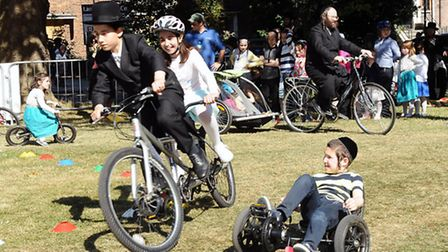 People having fun riding bikes around a cycle course, as part of a cycle roadshow workshop at the Sh