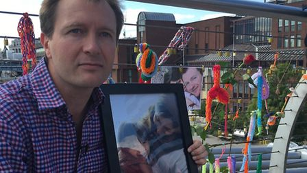 Richard Ratcliffe with padlocks tied to a bridge to mark his 7th wedding anniversary without Nazanin