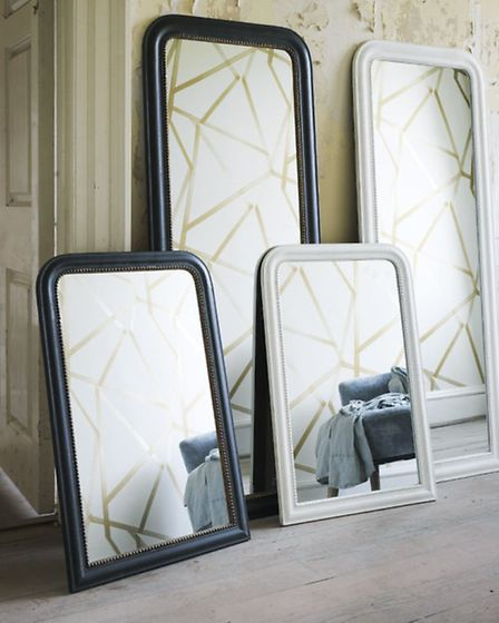 Setting beaded antique mirrors on the floor reflects light around the room and opens up the space. F