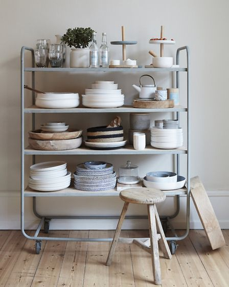 Display your crockery on open shelves. Tableware from Ecora, Belsize Park