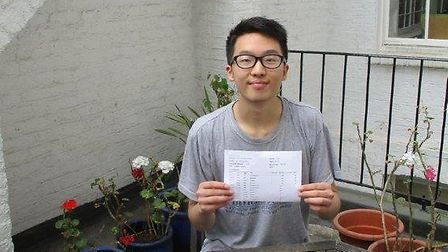 Student Jerry Chang celebrates his A* A A A results