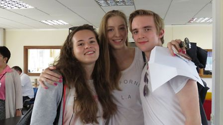 Portland Place students Emanuelle Chalupa, Amiee Douglas and Harry England celebrate their results