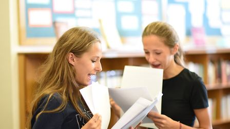 Twins Olivia and Amanda collect theur results together at Channing