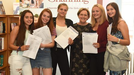 Students pose with teachers after their results at Channing school