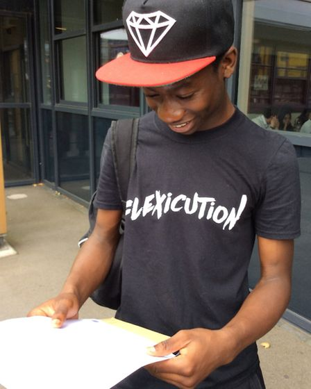 Achievement: Ade Taiwo with his GCSE transcript at Mossbourne Community Academy today (Picture: Moss