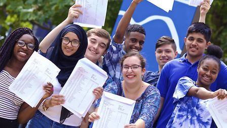 A group of students pose with their results at Paddington Academy