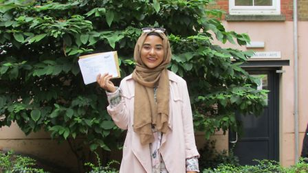 Hackney community college student Amina Ben-Haddouch with her transcript
