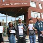 A group of students pose with their results at Cardinal Pole school