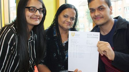 Student Sohail Khan showing off his results with his mum and sister