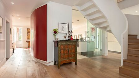 The property boasts all sorts of impressive features, including a grand central staircase