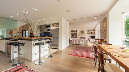 The large kitchen is modern with top of the range appliances