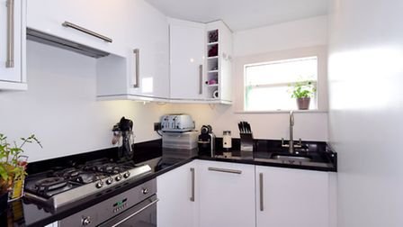 There is a compact modern kitchen