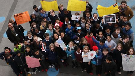 Children from Millfields Community School cheer up as they raise around 1,500 pounds to help poor pe