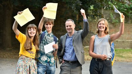 Students from Acland Burghley school celebrate with their headmaster