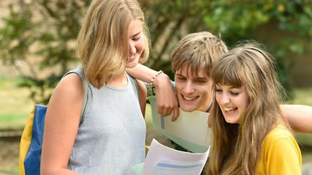 Students Maya Eadie-Catling, Jonathan Lloyd and Kate Winter look through their results yesterday
