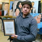 Artist Kevin Gill at his studio in Leyton. Holding a letter from President Barack Obama sent in reco