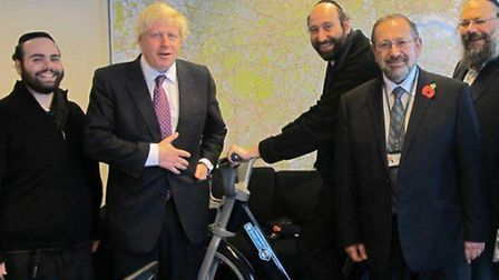 Cllr Simche Steinberger cannot ride a bike but is pictured with one in 2010 alongside Boris Johnson,