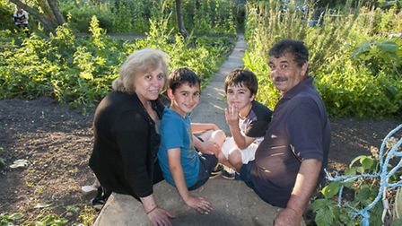 Demetrios and Efrosyni Georgiou at their Muswell Hill allotment with grandsons Peter�and James Ioann