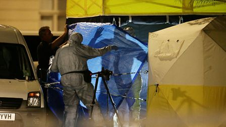 Police forensic officers at work in Russell Square, central London, after a knife attack in which a