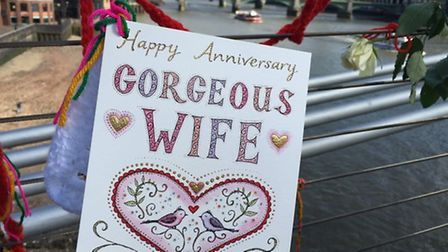 A card and wool memory knots tied to the bridge to mark Richard and Nazanin's wedding anniversary