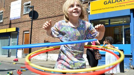 Finlay Dickson, nine, hula hoops at the circus skills area. (picture: Polly Hancock).