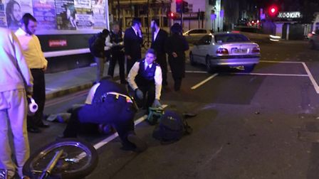 Police treating the injured man. (Picture: @999London).