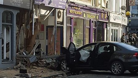 The car crashed into Mr Dweeb PC shop. Credit: Dominic Black