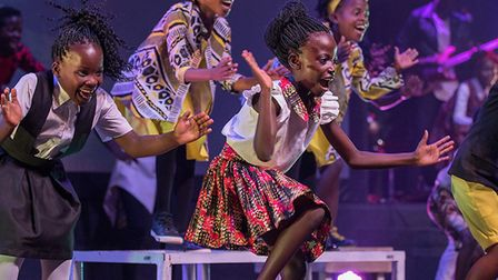 Children from the Watoto Children's Choir performing on stage during a previous concert. Picture: Co