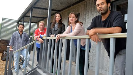 Outside the 'beach hut' on top of The Art House in Laburnum Street. From left: Harley Gray, site man