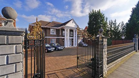 The 'Palladian style' house is set behind automatic security gates and a carriage driveway